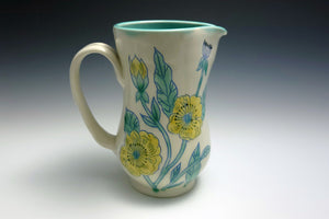 Pitcher with yellow flowers