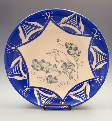Decorative plate with bird drawing