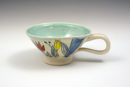 Small tea cup with tulips