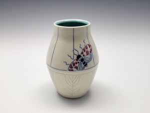 Vase with colorful moths