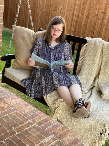 Taylor reading Book 1 in the Fox Hollow Series