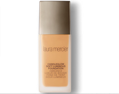 Laura Mercier bottle on white background