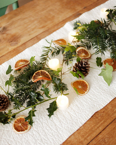 Table greenery with dried orange slices