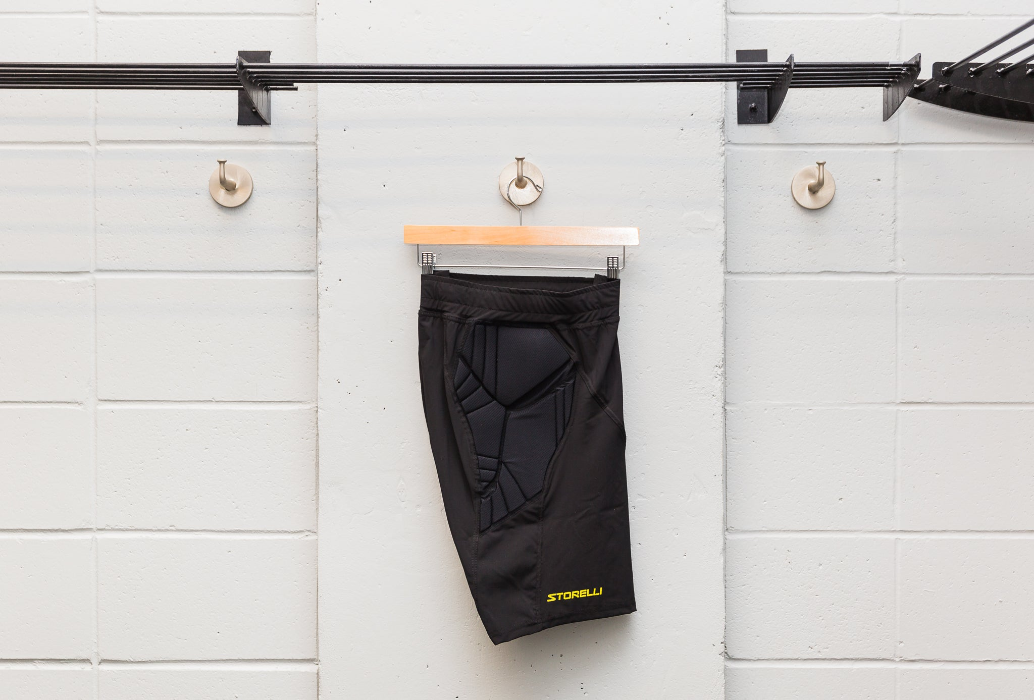 storelli sports bodyshield goalkeeper shorts hanging from hangar in locker room