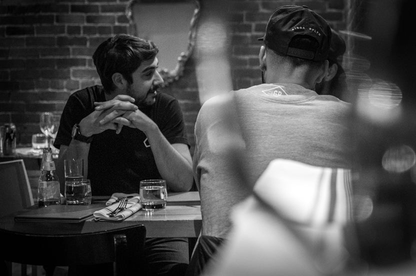 black and white image of meeting in restaurant_3