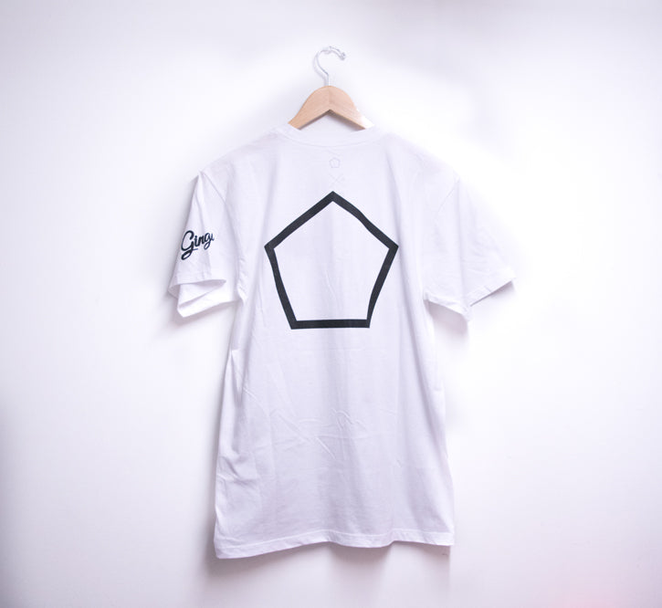 picture of the backside of a white t-shirt with hanger hung against a white wall. T-shirt has a pentagon printed in black.