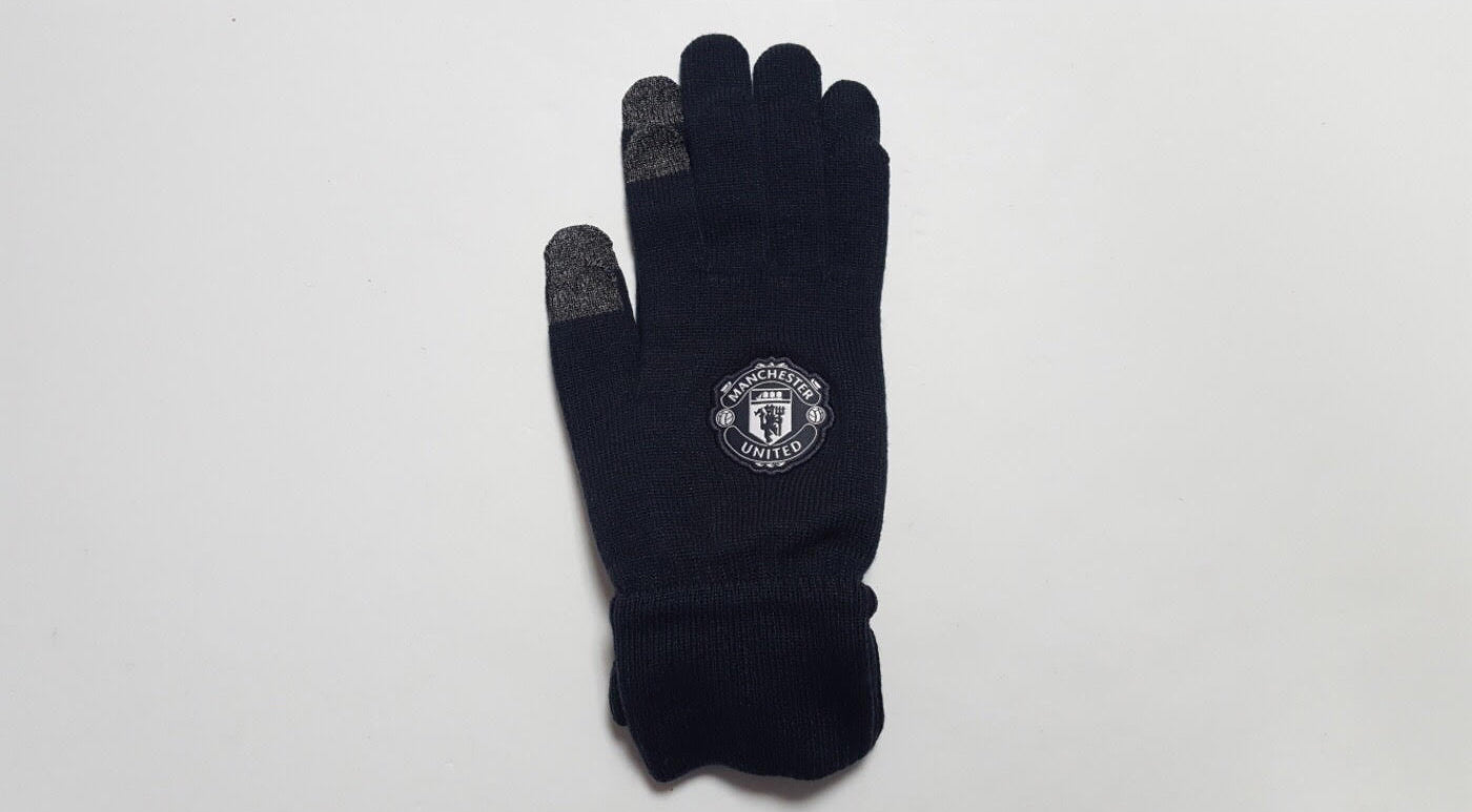 black knitted winter gloves made by adidas with manchester united crest embroidered