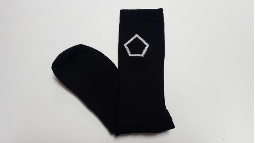 black performance crew socks with with pentagon logo