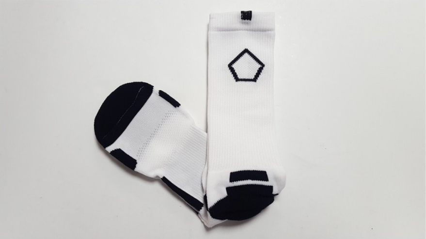 white performance crew socks with black pentagon
