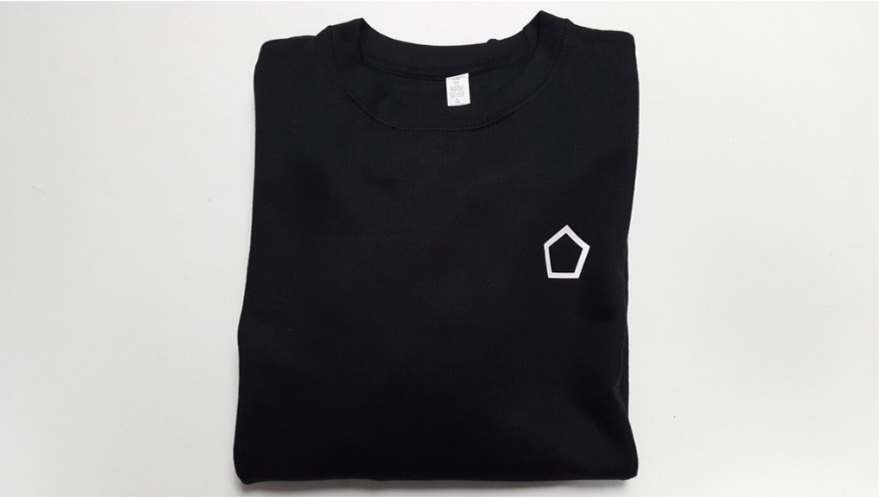 black crewneck sweater with white pentagon logo heart side.