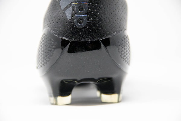 adidas black f50 adizero soccer cleat with plastic studs - close up of heel