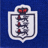 Detailed view of the badge of an England Beanie