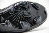 adidas black f50 adizero soccer cleat with plastic studs - close up of outsole