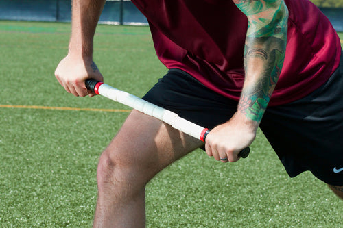 picture showing a male athlete massage leg muscle using a handheld plastic stick