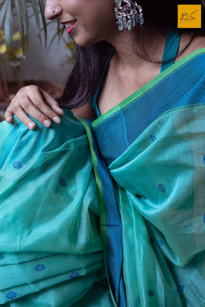 An exclusive silk cotton Maheshwari handwoven saree with silk thread border and pallu.