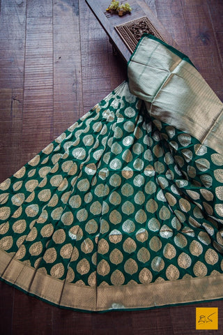 This is a gorgeous Banarasi Katan Silk Handwoven Saree with intricate buttas in fekuva style. This sari is suitable for formal occasions. A contrast blouse looks great with this saree. New trend of Banarasi Saree designs, Banarasi Saree for artists, art lovers, architects, saree lovers, Saree connoisseurs, musicians, dancers, doctors, Banarasi silk saree, indian saree images, latest sarees with price, only saree images, new Banarasi saree design.