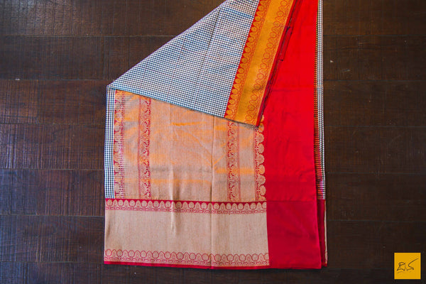 This is a gorgeous Banarasi Silk Saree with black checks woven on white and red kadhiyal border. The blouse is in red with intricate brocade zari work. New trend of Banarasi Saree designs, Banarasi Saree for artists, art lovers, architects, saree lovers, Saree connoisseurs, musicians, dancers, doctors, Banarasi silk saree, indian saree images, latest sarees with price, only saree images, new Banarasi saree design.