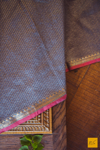 This is a gorgeous Banarasi tussar silk handwoven Saree with silver and gold zari patterned stripes and small border with red selvedge. The blouse is also unique with sona rupa zari patterned stripes. New trend of Banarasi Saree designs, Banarasi Saree for artists, art lovers, architects, saree lovers, Saree connoisseurs, musicians, dancers, doctors, Banarasi silk saree, indian saree images, latest sarees with price, only saree images, new Banarasi saree design.