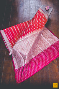 A beautiful katan silk banarasi handwoven sari with orange and red body beautified by kadhwa buttas. New trend of Banarasi Saree designs, Banarasi Saree for artists, art lovers, architects, saree lovers, Saree connoisseurs, musicians, dancers, doctors, Banarasi Katan silk saree, indian saree images, latest sarees with price, only saree images, new Banarasi saree design.