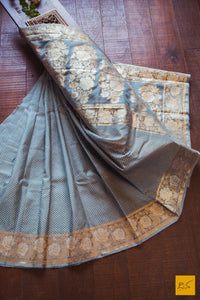 A lovely grey banarasi kora silk saree with small white buttas and exclusive sona and rupa border with rose buttas and pallu. New trend of Banarasi Saree designs, Banarasi Saree for artists, art lovers, architects, saree lovers, Saree connoisseurs, musicians, dancers, doctors, Banarasi silk saree, indian saree images, latest sarees with price, only saree images, new Banarasi saree design.
