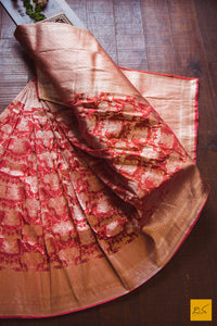 This is a beautiful katan silk banarasi sari with a red body and a unique zari jaal. New trend of Banarasi Saree designs, Banarasi Saree for artists, art lovers, architects, saree lovers, Saree connoisseurs, musicians, dancers, doctors, Banarasi Katan silk saree, indian saree images, latest sarees with price, only saree images, new Banarasi saree design.