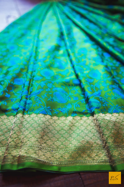 A beautiful katan silk banarasi handwoven sari with a green body. The zari border is the highlight of the saree. New trend of Banarasi Saree designs, Banarasi Saree for artists, art lovers, architects, saree lovers, Saree connoisseurs, musicians, dancers, doctors, Banarasi Katan silk saree, indian saree images, latest sarees with price, only saree images, new Banarasi saree design.
