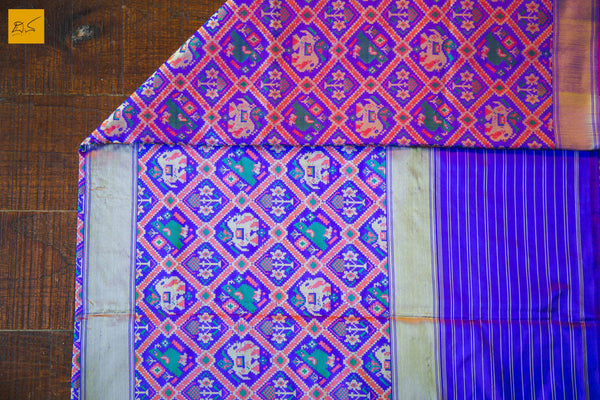 This is a gorgeous Banarasi Patola Silk Handwoven Saree with elephants and parrots woven on it. A master piece by itself. It has a plain blouse with woven border. New trend of Banarasi Saree designs, Banarasi Saree for artists, art lovers, architects, saree lovers, Saree connoisseurs, musicians, dancers, doctors, Banarasi silk saree, indian saree images, latest sarees with price, only saree images, new Banarasi saree design.