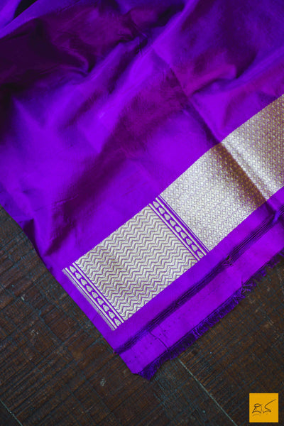 This is a gorgeous Banarasi silk handwoven Saree where the border is in purple colour. The pink part is of pure silk and buttas woven on it. The white part is of tussar silk in natural colour. The blouse is in purple with woven border. New trend of Banarasi Saree designs, Banarasi Saree for artists, art lovers, architects, saree lovers, Saree connoisseurs, musicians, dancers, doctors, Banarasi silk saree, indian saree images, latest sarees with price, only saree images, new Banarasi saree design.