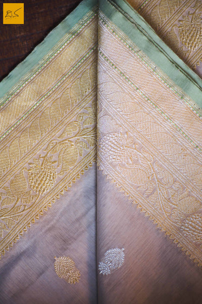 A lovely Banarasi cotton saree with white body and green slevedge. The body has golden silver buttas woven in it. The blouse is of golden brocade intricately woven. New trend of Banarasi Saree designs, Banarasi Saree for artists, art lovers, architects, saree lovers, Saree connoisseurs, musicians, dancers, doctors, Banarasi Katan silk saree, indian saree images, latest sarees with price, only saree images, new Banarasi saree design.