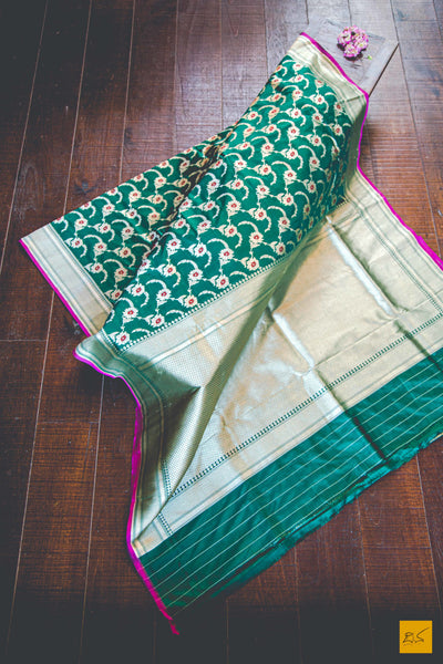 This is a gorgeous Banarasi Katan Silk Handwoven Jangla Saree with lovely hints of Meenakari. New trend of Banarasi Saree designs, Banarasi Saree for artists, art lovers, architects, saree lovers, Saree connoisseurs, musicians, dancers, doctors, Banarasi silk saree, indian saree images, latest sarees with price, only saree images, new Banarasi saree design.