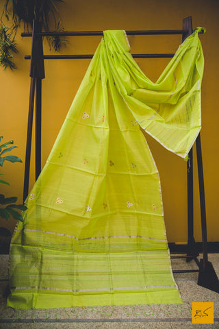 This is a gorgeous chanderi silk cotton handwoven dupatta with lime green body adorned with meenakari eknaal buttas. New trend of chanderi pure silk dupatta designs, chanderi pure Silk dupatta for artists, art lovers, architects, dupatta lovers, dupatta connoisseurs, musicians, dancers, doctors, chanderi pure Silk dupatta, indian dupatta images, latest dupattas with price, only dupatta images, new chanderi pure silk dupatta design.