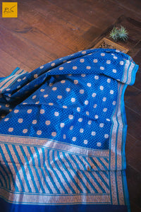 This beautiful Blue Cotton Banarasi Saree consists of blue design with zari and small buttas. Exclusive and classic example of Banarasi cutwork. Very easy to drape and comfortable. New trend of Banarasi Saree designs, Banarasi Saree for artists, art lovers, architects, saree lovers, Saree connoisseurs, musicians, dancers, doctors, Banarasi silk saree, indian saree images, latest sarees with price, only saree images, new Banarasi saree design.