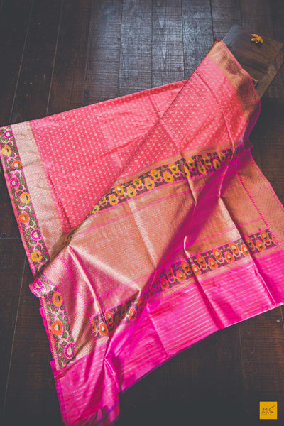 This is a gorgeous Banarasi Silk Handwoven Saree with meenakari phulari border and pallu. The phulari border is so exquisite that it makes the saree stand out. The saree has small star meena buttas. The blouse is pink in colour with the border. New trend of Banarasi Saree designs, Banarasi Saree for artists, art lovers, architects, saree lovers, Saree connoisseurs, musicians, dancers, doctors, Banarasi silk saree, indian saree images, latest sarees with price, only saree images, new Banarasi saree design.
