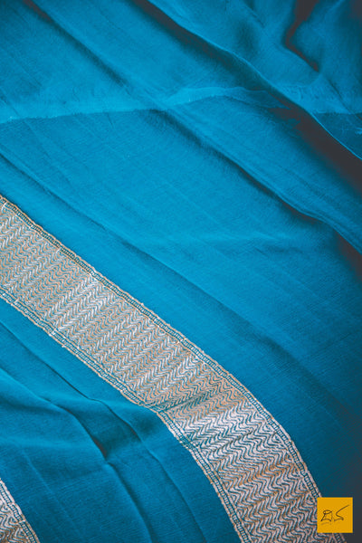This wonderful Banarasi Georgette Saree consists of shades of Blue in this body. New trend of Banarasi Saree designs, Banarasi Saree for artists, art lovers, architects, saree lovers, Saree connoisseurs, musicians, dancers, doctors, Banarasi silk saree, indian saree images, latest sarees with price, only saree images, new Banarasi saree design.