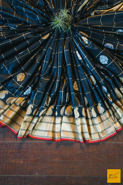 A beautiful banarasi silk handwoven sari with kadhwa buttas in gold and silver zari. The body has checks woven in zari and a red selvedge. New trend of Banarasi Saree designs, Banarasi Saree for artists, art lovers, architects, saree lovers, Saree connoisseurs, musicians, dancers, doctors, Banarasi silk saree, indian saree images, latest sarees with price, only saree images, new Banarasi saree design.