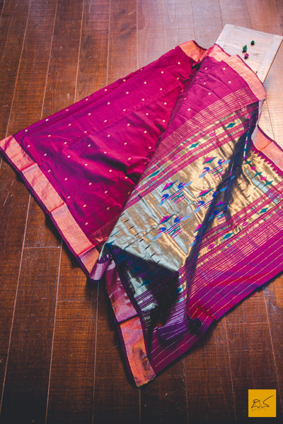 A lovely maroon traditional handwoven pure cotton paithani saree. New trend of Saree designs, Saree for artists, art lovers, architects, saree lovers, Saree connoisseurs, musicians, dancers, doctors, silk saree, indian saree images, latest sarees with price, only saree images, new saree design.