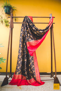 A classy combination of black and red coming together in this black and red banarasi munga silk dupatta, statement piece