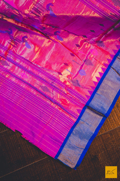 A lovely pink and blue paithani cotton handwoven saree. New trend of Saree designs, Saree for artists, art lovers, architects, saree lovers, Saree connoisseurs, musicians, dancers, doctors, silk saree, indian saree images, latest sarees with price, only saree images, new saree design.