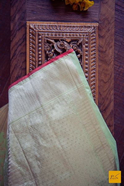 A beautiful katan silk banarasi handwoven sari with all over intricate jaal and red slevedge. The blouse is of the green colour with woven border. New trend of Banarasi Saree designs, Banarasi Saree for artists, art lovers, architects, saree lovers, Saree connoisseurs, musicians, dancers, doctors, Banarasi Katan silk saree, indian saree images, latest sarees with price, only saree images, new Banarasi saree design.