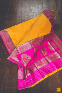 This is a beautiful banarasi katan silk handwoven sari a yellow and pink body which is dyed and woven with different colour which makes it authentic Kadhiyal. New trend of Banarasi Saree designs, Banarasi Saree for artists, art lovers, architects, saree lovers, Saree connoisseurs, musicians, dancers, doctors, Banarasi Katan silk saree, indian saree images, latest sarees with price, only saree images, new Banarasi saree design.