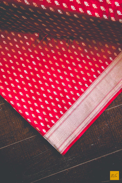 A beautiful katan silk banarasi handwoven sari with a red body and intricate woven buttas in cutwork style. New trend of Banarasi Saree designs, Banarasi Saree for artists, art lovers, architects, saree lovers, Saree connoisseurs, musicians, dancers, doctors, Banarasi Katan silk saree, indian saree images, latest sarees with price, only saree images, new Banarasi saree design.