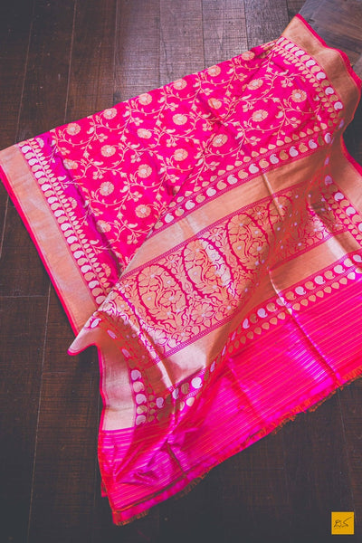 A beautiful katan silk banarasi jangla handwoven sari with a pink body and kadhwa sona rupa zari intricate weaves in pink-orange colour. New trend of Banarasi Saree designs, Banarasi Saree for artists, art lovers, architects, saree lovers, Saree connoisseurs, musicians, dancers, doctors, Banarasi Katan silk saree, indian saree images, latest sarees with price, only saree images, new Banarasi saree design.