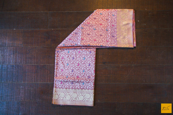 This is a gorgeous Banarasi Handwoven Silk Saree withmeena patola all over the body. The saree has a golden phulkari border. The meena work is so exquisite that it makes the saree adorable. The blouse is of rose pink colour with border. New trend of Banarasi Saree designs, Banarasi Saree for artists, art lovers, architects, saree lovers, Saree connoisseurs, musicians, dancers, doctors, Banarasi silk saree, indian saree images, latest sarees with price, only saree images, new Banarasi saree design.