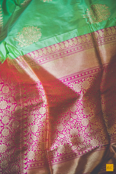 This is a beautiful katan silk banarasi sari with a pink border and kadhwa motifs. It's speciality is its Kadhiyal border. It is dyed and woven with different colour which makes it the authentic Kadhiyal. New trend of Banarasi Saree designs, Banarasi Saree for artists, art lovers, architects, saree lovers, Saree connoisseurs, musicians, dancers, doctors, Banarasi Katan silk saree, indian saree images, latest sarees with price, only saree images, new Banarasi saree design.