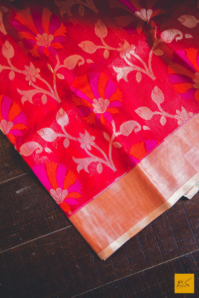 A lovely bright pink orange banarasi kora silk organza handwoven saree. New trend of kota silk Saree designs, Saree for artists, art lovers, architects, saree lovers, Saree connoisseurs, musicians, dancers, doctors, kota silk saree, indian saree images, latest sarees with price, only saree images, new kota silk saree design.
