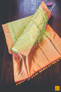 A beautiful katan silk banarasi handwoven sari withan exquisite jhaldar pattern and subtle hints of meenakari art. New trend of Banarasi Saree designs, Banarasi Saree for artists, art lovers, architects, saree lovers, Saree connoisseurs, musicians, dancers, doctors, Banarasi Katan silk saree, indian saree images, latest sarees with price, only saree images, new Banarasi saree design.