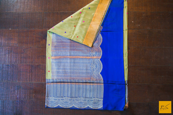 This is a gorgeous Banarasi silk Saree with colourful meena motifs woven in kadhwa style. The green body is of tussar silk and the blue border pallu and blouse are in pure silk. The blouse is blue in colour with woven border. New trend of Banarasi Saree designs, Banarasi Saree for artists, art lovers, architects, saree lovers, Saree connoisseurs, musicians, dancers, doctors, Banarasi silk saree, indian saree images, latest sarees with price, only saree images, new Banarasi saree design.