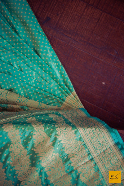 This is a beautiful katan silk banarasi sari with small round buttas woven in fekuva also called as cutwork style. New trend of Banarasi Saree designs, Banarasi Saree for artists, art lovers, architects, saree lovers, Saree connoisseurs, musicians, dancers, doctors, Banarasi Katan silk saree, indian saree images, latest sarees with price, only saree images, new Banarasi saree design.