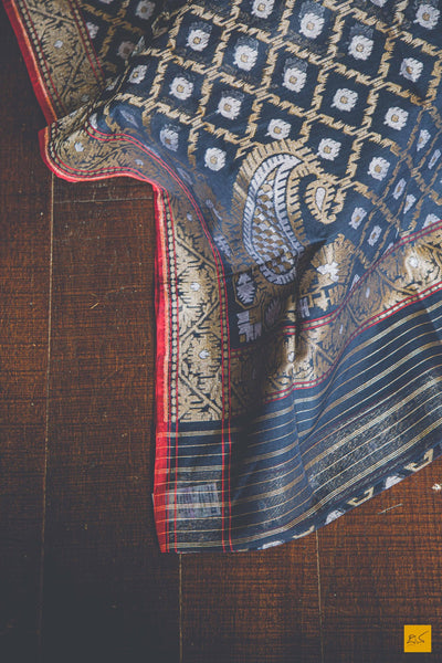 This is a magnificent Banarasi Jamdani handwoven Saree with a grey body and exquisite jamdani weave with golden and silver zari. New trend of Banarasi Saree designs, Banarasi Saree for artists, art lovers, architects, saree lovers, Saree connoisseurs, musicians, dancers, doctors, Banarasi silk saree, indian saree images, latest sarees with price, only saree images, new Banarasi saree design.