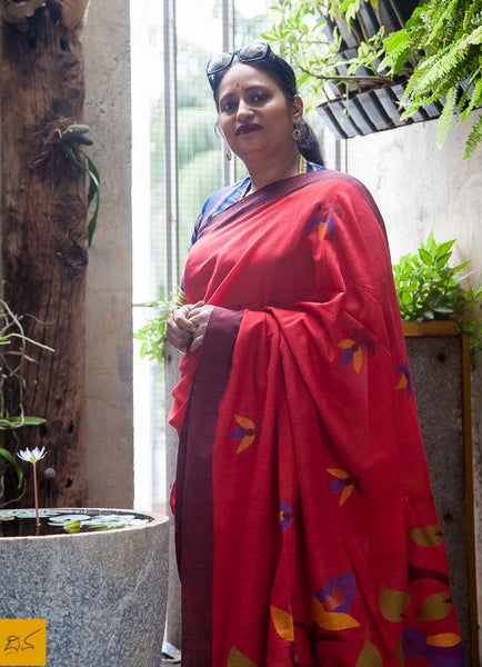 A lovely red khadi cotton Jamdani saree with buttas and beautifully woven pallu. New trend of Saree designs, Saree for artists, art lovers, architects, saree lovers, Saree connoisseurs, musicians, dancers, doctors, Katan silk saree, indian saree images, latest sarees with price, only saree images, new saree design.